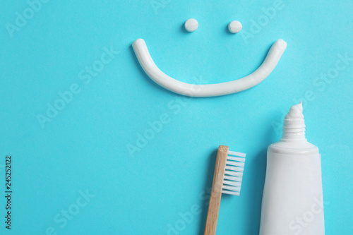 Foto op Plexiglas Wolf Smiling face made of toothpaste, tube, brush and space for text on color background, top view