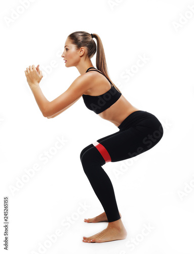 Sporty woman  doing a exersize  with resistance band.