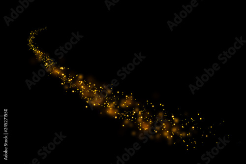 Fotografie, Tablou  Gold glitter particles lights trail and bokeh on a black background