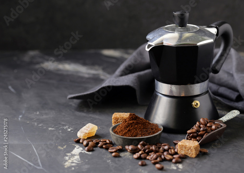 Obraz na płótnie still life of coffee, grains and ground on a black background
