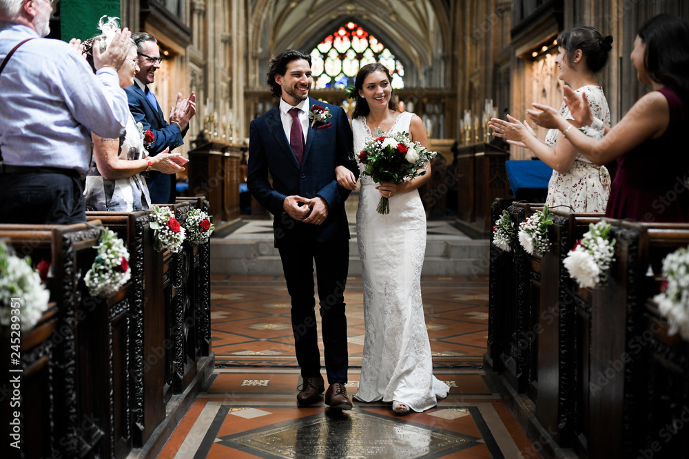 Fototapety, obrazy: Newly wed couple walking down the aisle