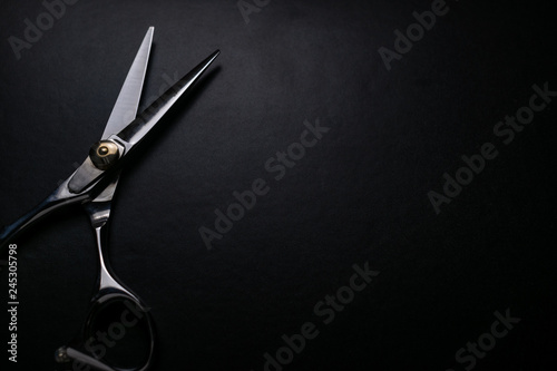 professional scissors on black background