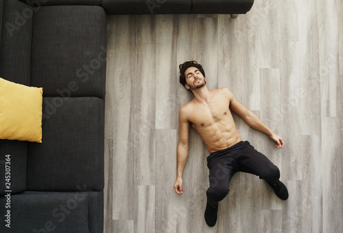 Fotografie, Obraz  Muscular Handsome Young Man Sleeping After Working Out at Home