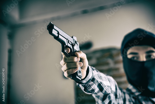 Fotomural  Closed up of hand's  Thief man stealing from a people wearing mask with a short gun