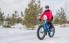 A Young Man Riding Fat Bicycle In The Winter. Fat Tire Bike.