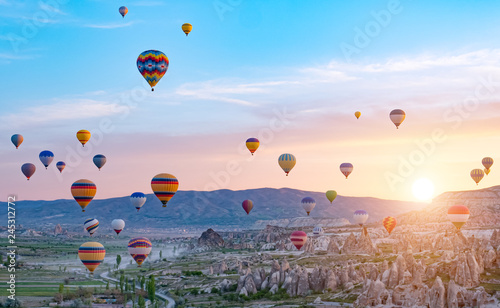 Aluminium Prints Balloon Colorful hot air balloons flying over rock landscape at Cappadocia Turkey