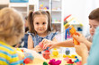 canvas print picture Group of kids playing with modeling clay in nursery