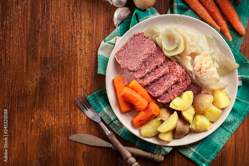 Obraz Corned beef and cabbage with potatoes and carrots - fototapety do salonu