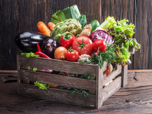 Fresh Multi-colored Vegetables In Wooden Crate. Wooden Background.
