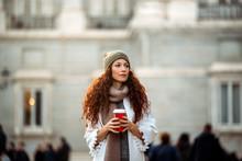 Woman Drinking Coffee Wanderin...