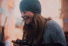 Laughing Woman With Camera