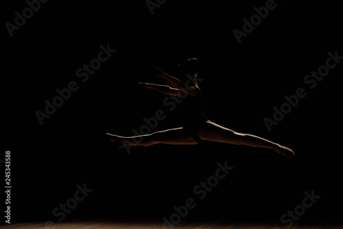 Spoed Fotobehang Muziek Young ballerina excited jumping in the studio or on the stage.