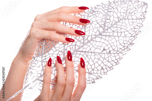 Photo Bright festive red manicure on female hands. Nails design