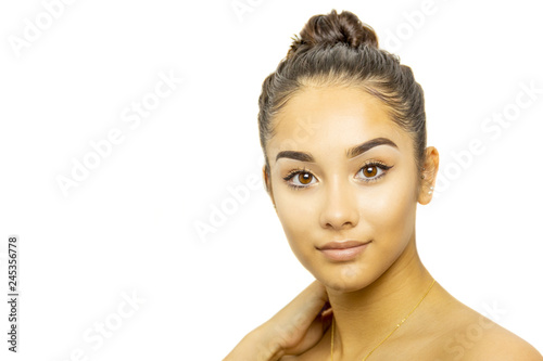 Foto  Mixed race young woman face portrait isolated on white background