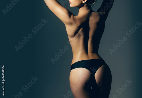 Deurstickers Akt Cellulite - skin problem and body care. Big ass. Buttocks after treatment. Woman in erotic underwear. Buttocks of girl in pants. Sexy woman. Fitness and diet. Sexy female fetish-wear. Beautiful body