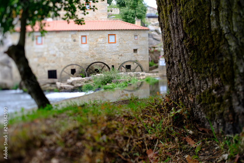 Photo  A picture with a Tilt and shift lens of a mill-house in Vilar de Mouros, Portugal