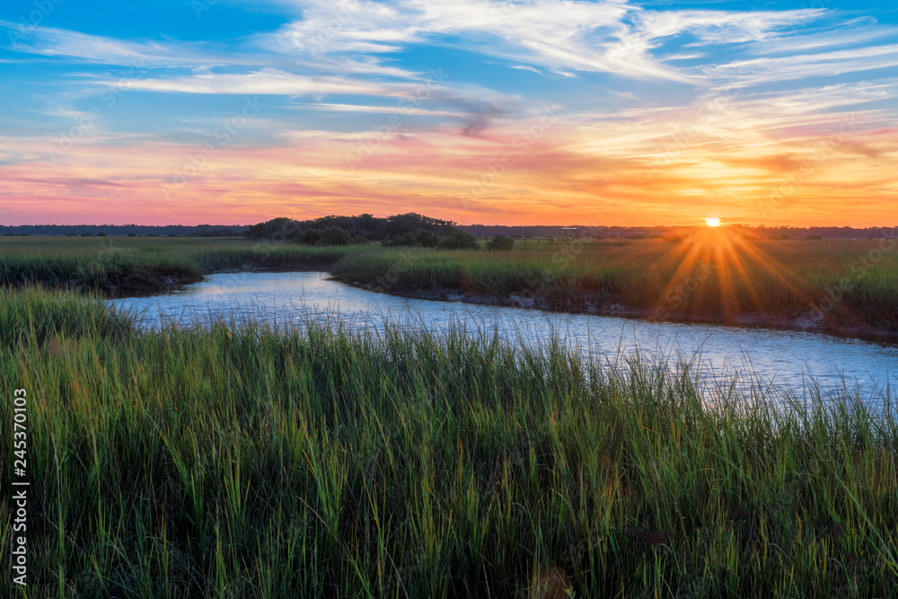 Fototapeta Sunset over a marshy branch of the Matanzas River in St. Augustine, Florida