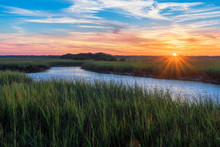Sunset Over A Marshy Branch Of...