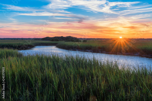 Fotografie, Obraz  Sunset over a marshy branch of the Matanzas River in St
