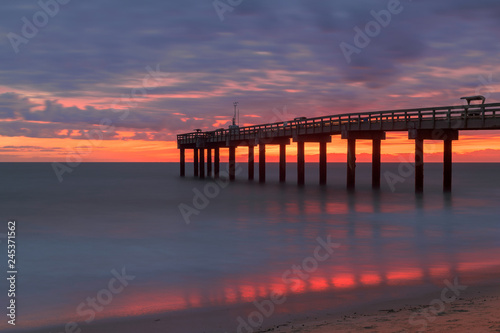 Canvas Prints Cappuccino Sunrise over the Atlantic Ocean at St. Augustine Beach Pier in St. Augustine, Florida