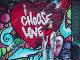 Fototapeta Młodzieżowe - Young woman by the wall with graffiti