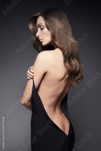 Fotobehang womenART Fashion photo of beautiful lady in black dress.