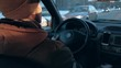 the man drive the car in city, during the cold season. 4k. taxi driver at work. slowmotion.