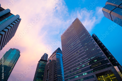Fotografia, Obraz  Office building business center at dusk in Bangkok, Thailand.