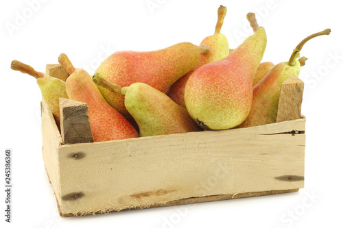 Fotografie, Obraz fresh and colorful Carmen pears in a wooden crate on a white background