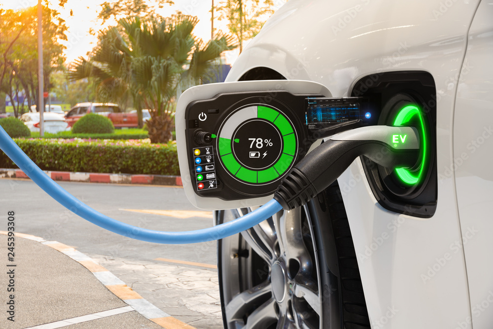 Fototapeta Electric vehicle changing on street parking with graphical user interface, Future EV car concept