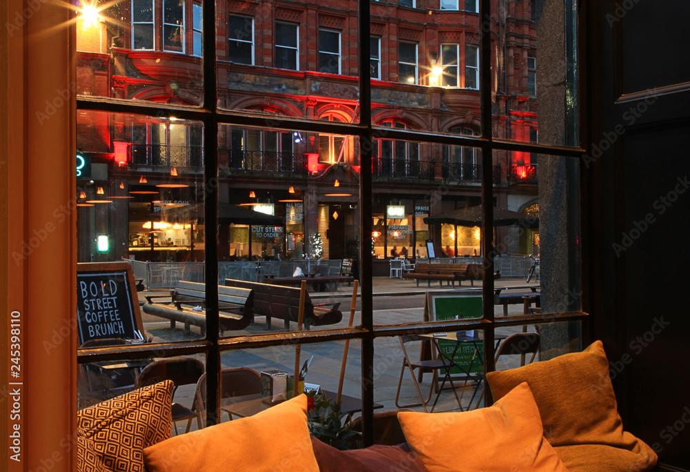 Fényképezés  Night view from cafe window to old European street
