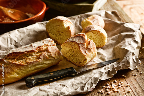 hot sliced bread on wooden table - rustic effect
