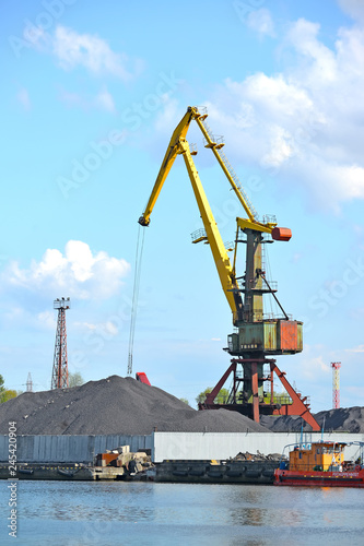 Fotobehang Poort KALININGRAD, RUSSIA. The port crane works at coal loading. Trade seaport