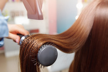 Shine Drying Long Brown Hair With Dryer And Round Brush After Spa Treatment. Female Master