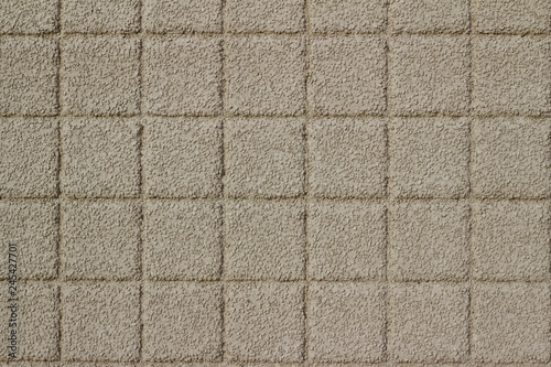 Valokuva Beige color exterior wall abstract background with conglomerate look square ston