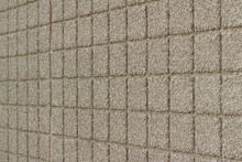 Angle View Of A Beige Color Exterior Wall Abstract Background With Conglomerate Look Square Stone Brick Tiles