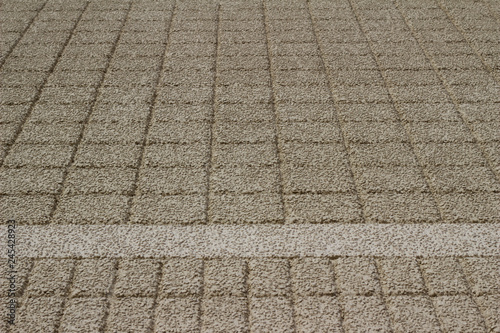 Fotografering  Upward view of a beige color exterior wall abstract background with conglomerate