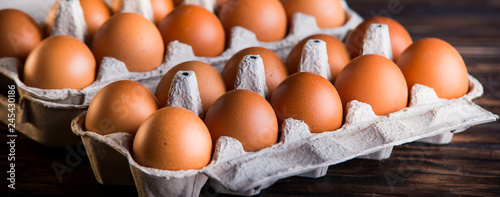 Fresh brown eggs on rustic table. Wallpaper Mural