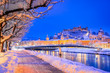 Leinwanddruck Bild - Salzburg, Austria: Winter viewof the historic city of Salzburg with famous Festung Hohensalzburg and Salzach river illuminated in beautiful twilight during scenic Christmas time in winter