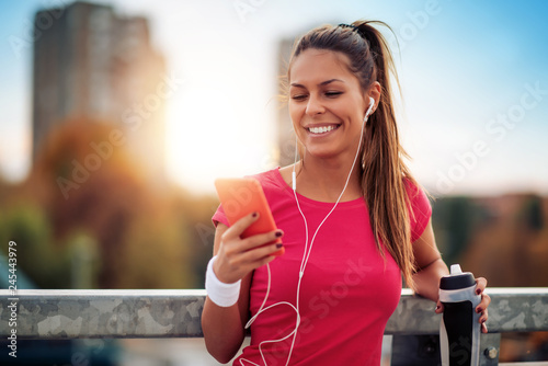 Young woman running in the city street - 245443979