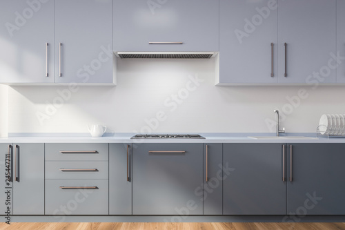 Photo Kitchen with gray countertops