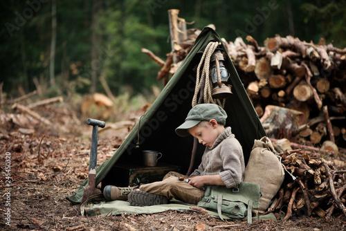 The boy, 5 years old, looks like a trapper, wanderer, lumberjack Canvas Print