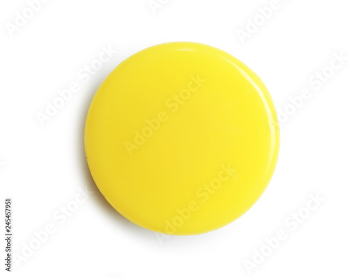 Poster Macarons Bright yellow plastic magnet on white background, top view