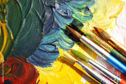 Different paint brushes on canvas, top view with space for text