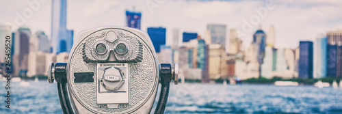 Tuinposter New York City New York City travel tourist attraction icon - coin binocular tower viewer on skyline background in summer. USA destination panoramic banner.