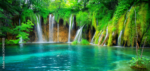 Poster Landscapes Exotic waterfall and lake landscape of Plitvice Lakes National Park, UNESCO natural world heritage and famous travel destination of Croatia. The lakes are located in central Croatia (Croatia proper).