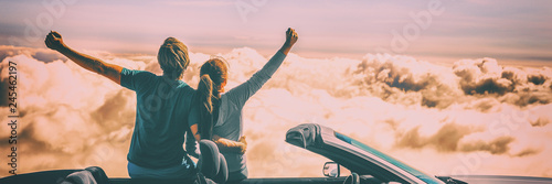 Fotografie, Obraz  Happy car people excited with arms up on road trip