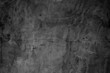 Black concreted wall for interiors texture background..