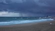 Empty beach of Balearic Sea at February evening severe windy weather