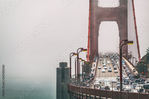 Fotobehang Amerikaanse Plekken San Francisco Golden Gate Bridge in fog background . Traffic, cars commuters people urban lifestyle scene.